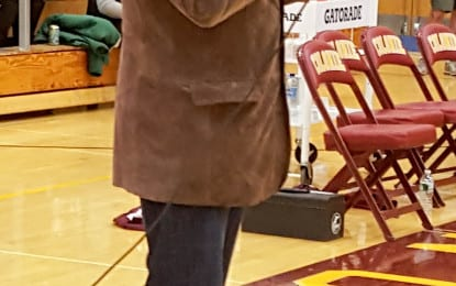 Returning to his roots: former NFL receiver David Gamble speaks at halftime of Colonie-Guilderland game