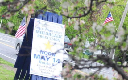A community raises flags to honor fallen local heroes