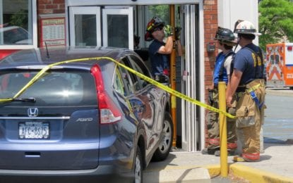 Car crashes into Colonie store front