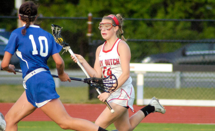 Guilderland's Jamie Golderman brings the ball into Shaker's half of the field. Rob Jonas/Spotlight
