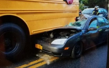 Car collides with school bus, no injuries