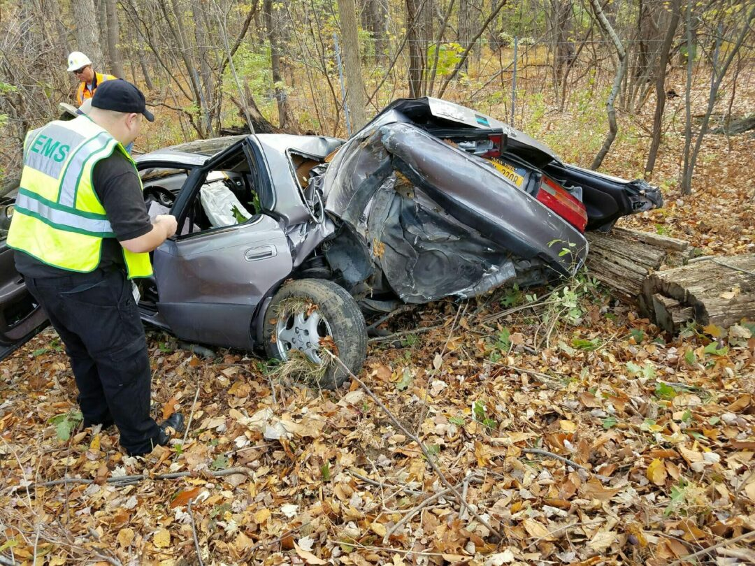 Vehicle rolls over on Thruway, entraps occupants