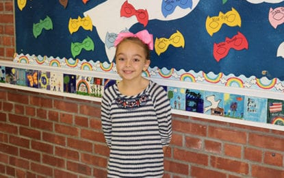 Latham fourth grader raises $300 for charity