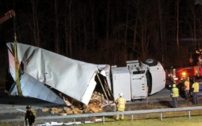 Box truck overturns on Thruway — good Samaritans help driver walk away, divert holiday traffic