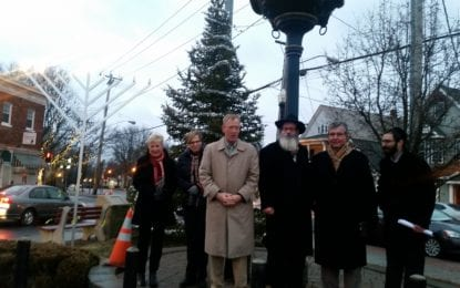 A menorah is lit at Four Corners
