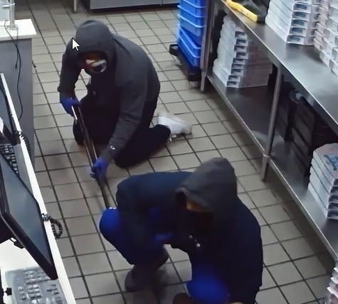 Central Avenue Dominos robbed at gunpoint, two suspects sought