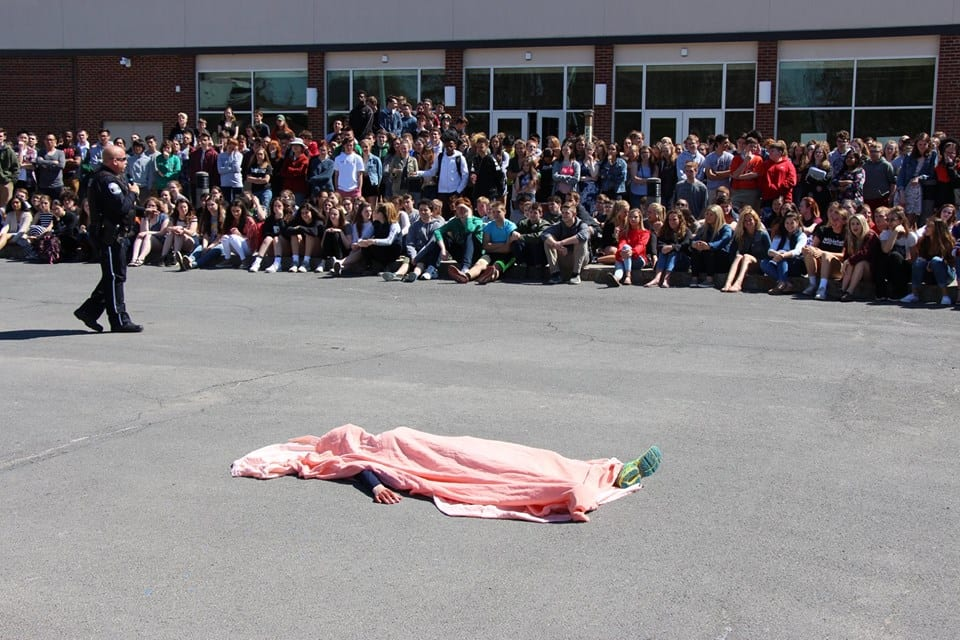 Mock crash offers high school students sobering view of DWI aftermath