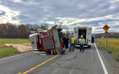 Transport truck turned over on River Road