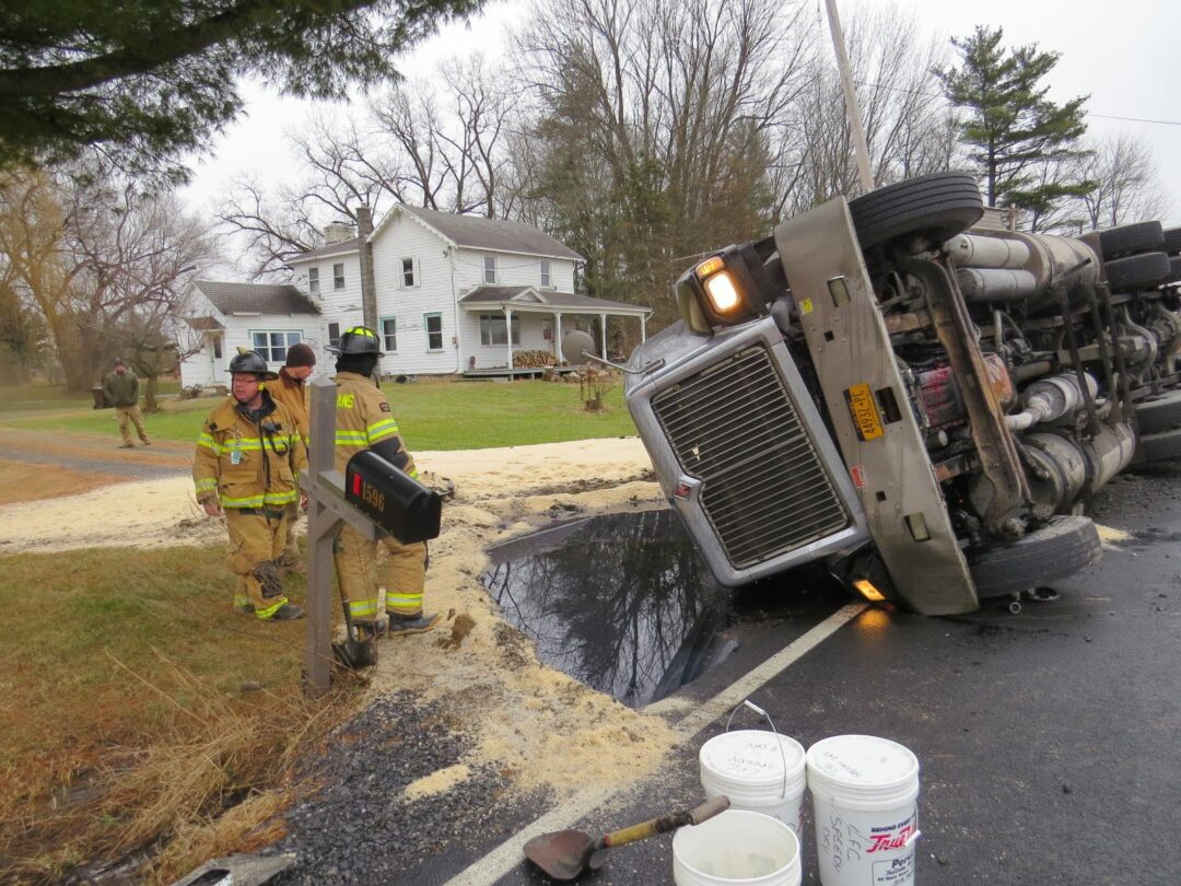 Semi-truck carrying salt rolls over in Coeymans