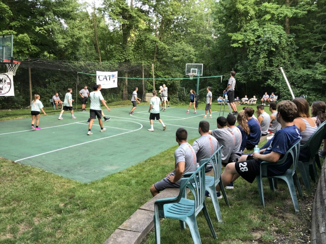 Each year, a Glenmont backyard hosts a 16-team volleyball tournament