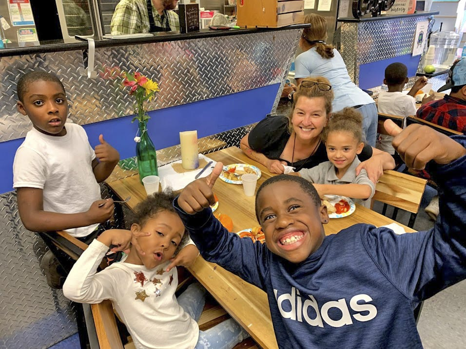 Local residents volunteer at Albany kitchen with purpose to feed neighborhood kids
